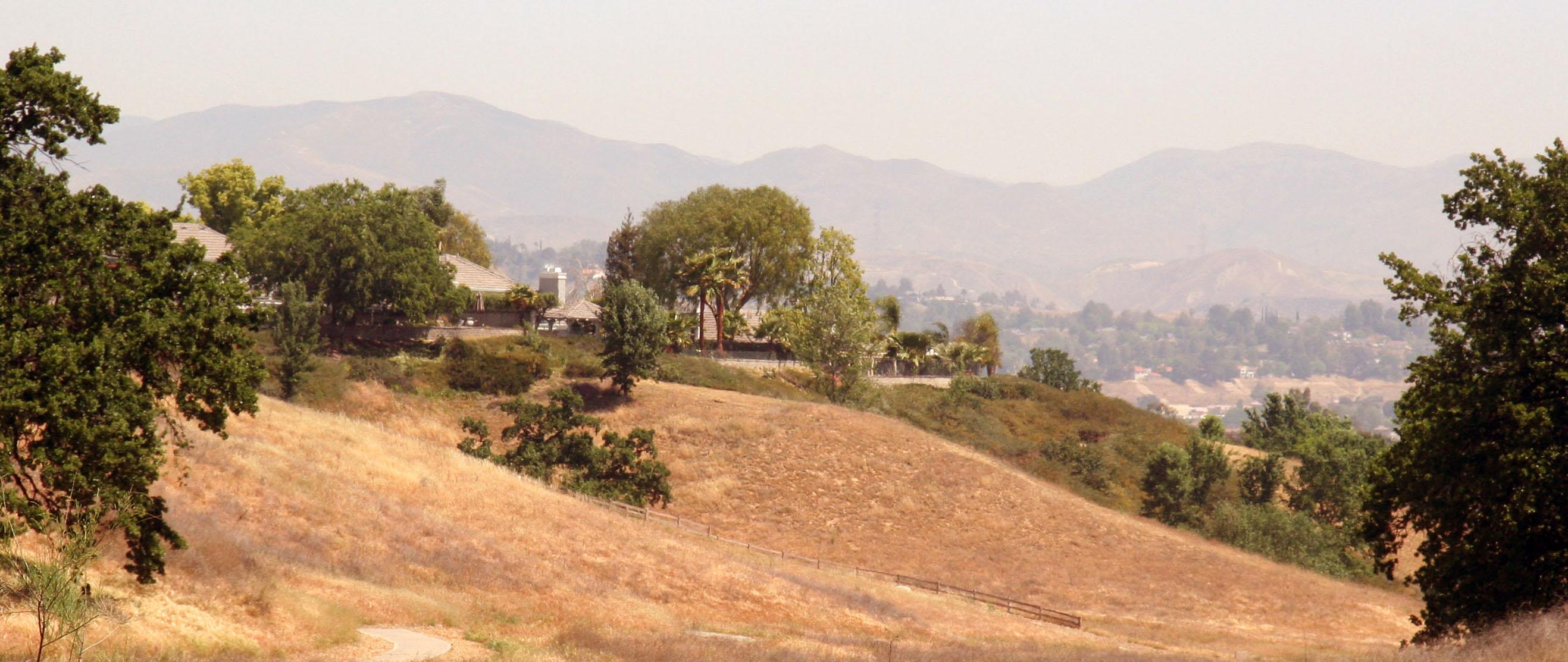 Valencia Summit homes and paseo hillsides